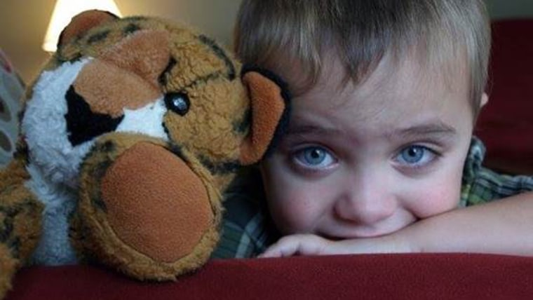 Image: Boy with stuffed animal