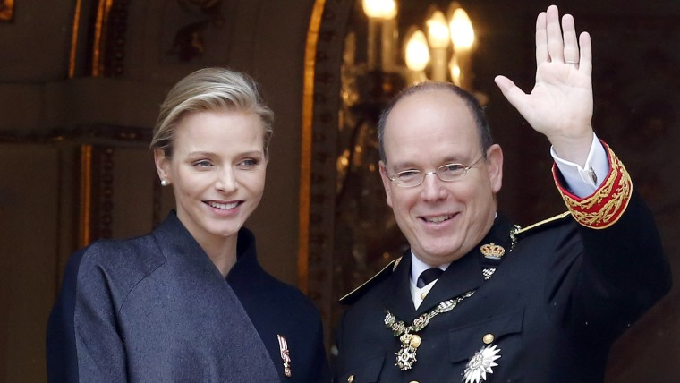 epa04232563 (FILE) A file picture dated 19 November 2013 shows Monaco's Prince Albert II and his wife, Princess Charlene attending the Army Parade dur...