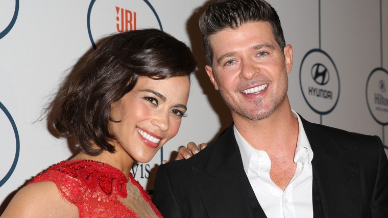 BEVERLY HILLS, CA - JANUARY 25:  Paula Patton (L) and singer Robin Thicke arrive at the 2014 HYUNDAI / GRAMMYs Clive Davis Pre-GRAMMY Gala Activation ...