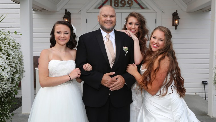 Kelvin Peters, 46, and his three youngest daughters.