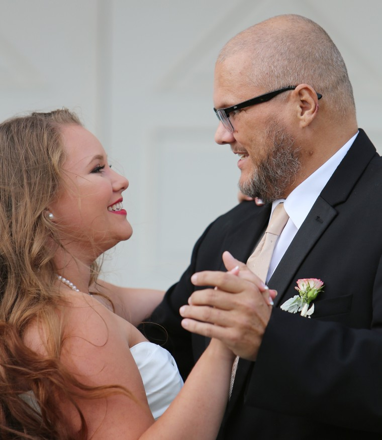 Kaitlin Peters, 21, dances with her dad.