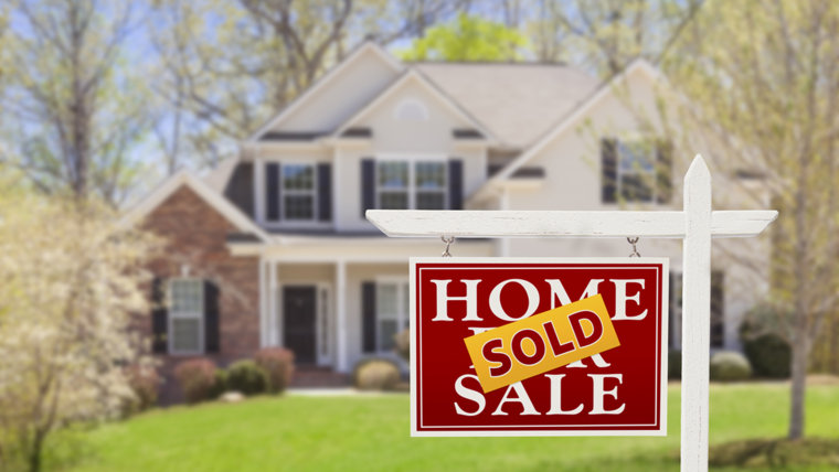 Sold Home For Sale Real Estate Sign and Beautiful New House.; Shutterstock ID 136157810; PO: TODAY.com