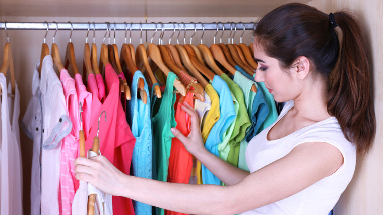 Young woman choose clothes in wardrobe at home; Shutterstock ID 189597512; PO: TODAY.com