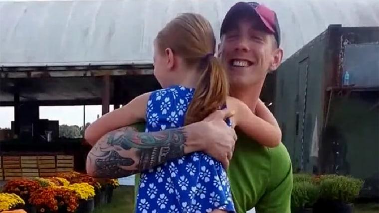 Dad surprises daughter at pumpkin patch