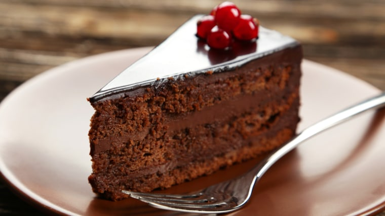 Dark chocolate cake on brown wooden background; Shutterstock ID 224415979; PO: TODAY.com