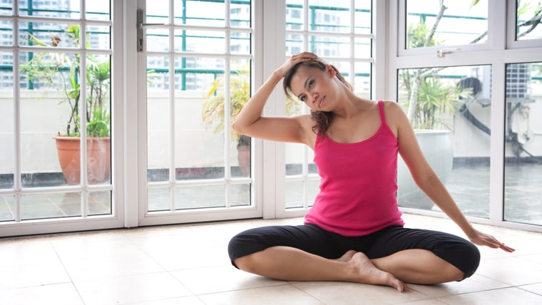 Young fitness woman stretching side of her neck; TODAY.com
