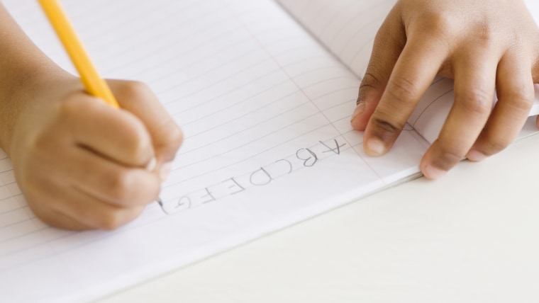 Mixed race girl writing ABC's (Blend Images via AP Images)
