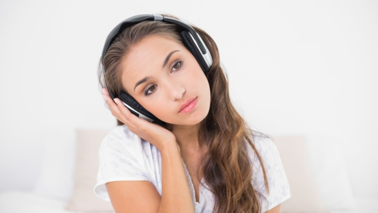 brunette listening to music in bright bedroom; Shutterstock ID 158709437; PO: TODAY.com