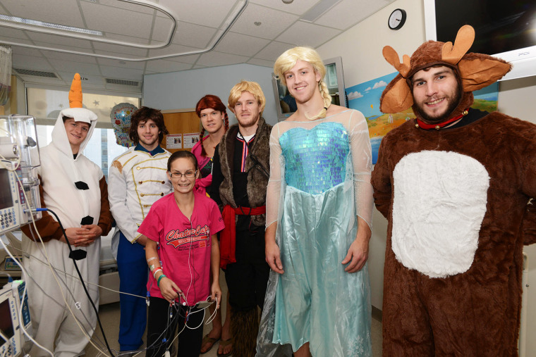 The visit to Boston Children's Hospital by the Boston Bruins was the latest in their annual Halloween trip to the hospital in which the players wear costumes.
