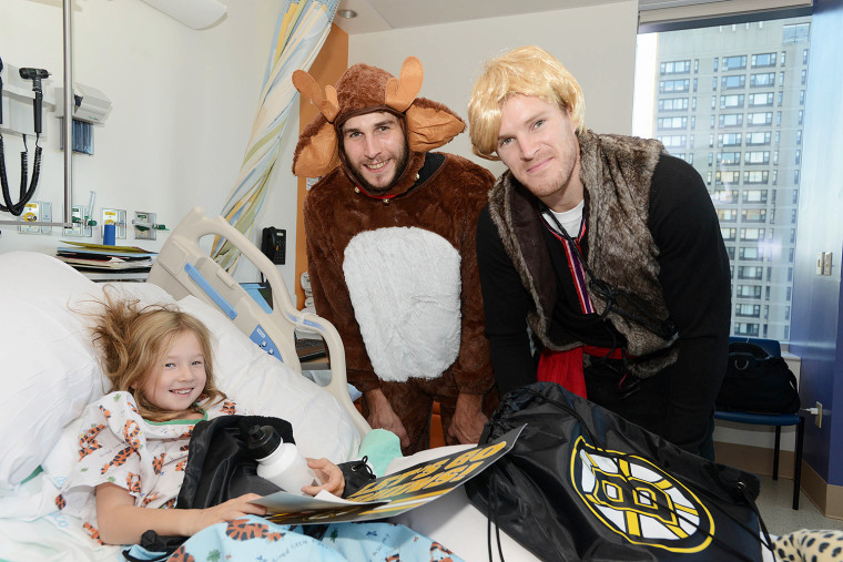 Boston Bruins Matt Bartkowski, and Kevan Miller spend time with Sarah at Boston Children's Hospital while dressed as Frozen characters.
