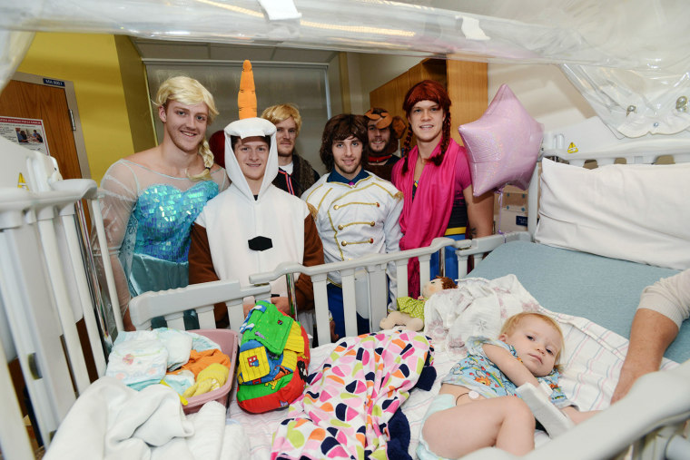 "Boston Bruins Dougie Hamilton, Torey Krug, Kevan Miller, Seth Griffith, Matt Bartkowski, and Matt Fraser, all dressed as characters from the hit movie ""Frozen,'' spent time with a patient named Michael at Boston Children's Hospital last Friday."