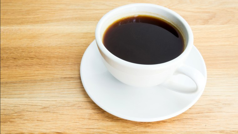 Black coffee on wooden table; Shutterstock ID 188572103; PO: today.com