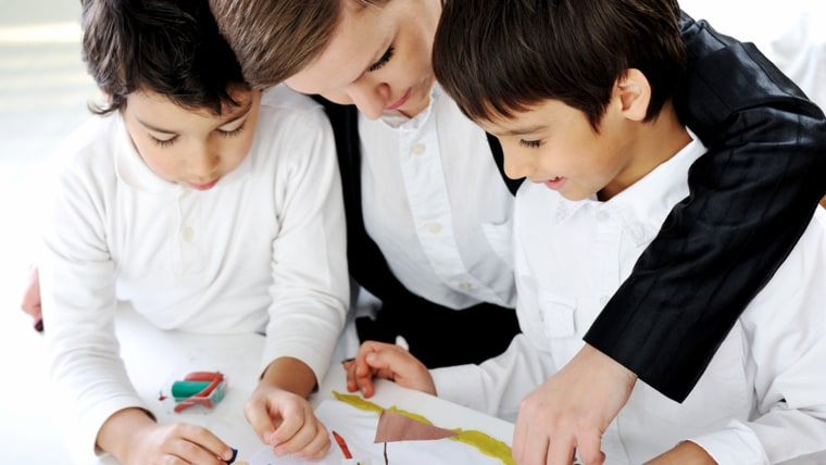 Mother working with sons on homework project; Shutterstock ID 110562605; PO: today.com