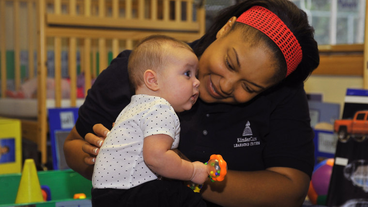 FREDERICK, MD - SEPTEMBER 30:  Nikia Crawford interracts with an infant before Laura DeBouchel received the Knowledge Universe Early Childhood Educato...