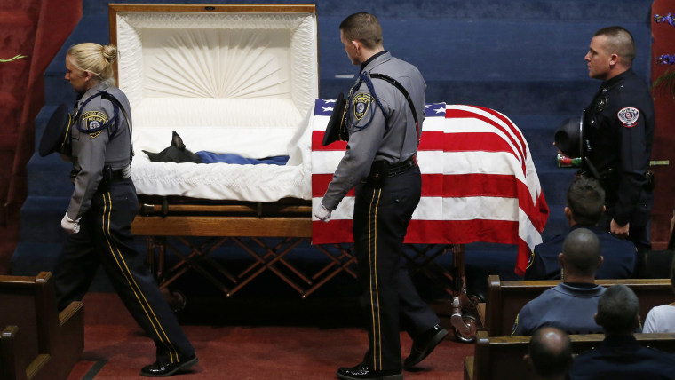 Police officers file past the casket of Oklahoma City police canine officer K-9 Kye during funeral services in Oklahoma City, Thursday, Aug. 28, 2014....