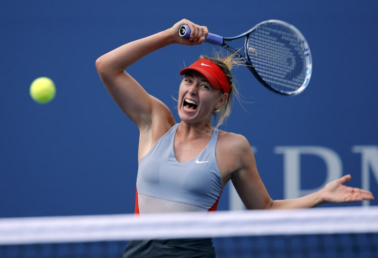 Maria Sharapova of Russia hits a return to Caroline Wozniacki of Denmark during their match at the 2014 U.S. Open tennis tournament in New York, Augus...