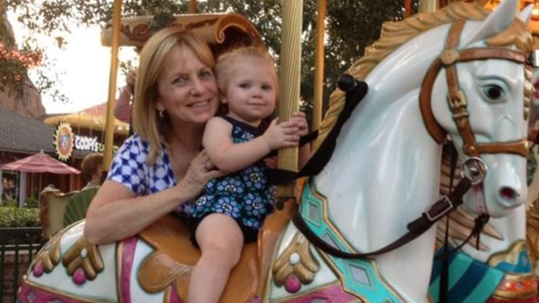 Granddaughter Noelle Dunham and her grandmother is Cynthia Petersen on the merry-go-round- at Downtown Disney.