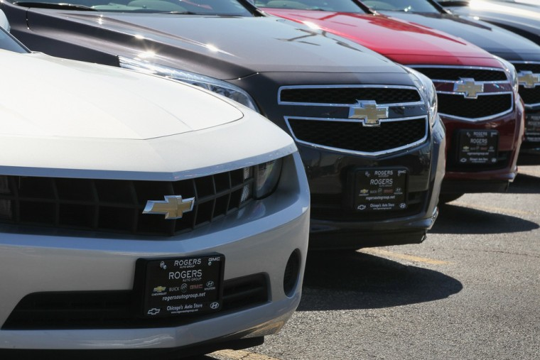 Chevrolet cars are offered for sale at a dealership on July 23, 2014, in Chicago, Illinois.