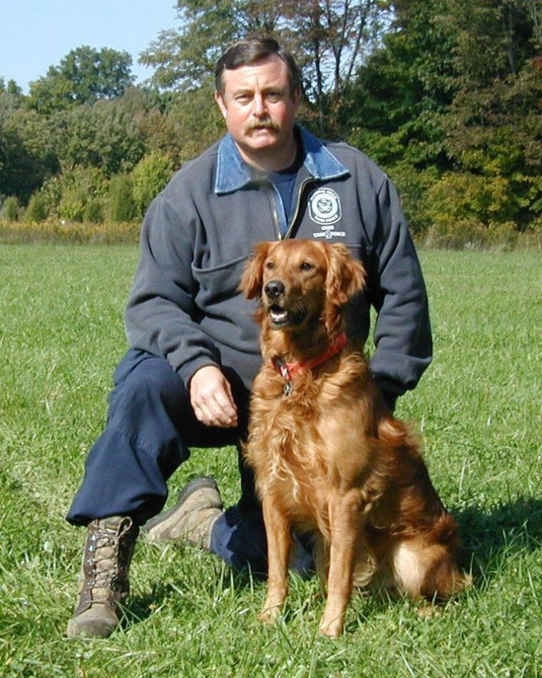 Terry Trepanier, a career firefighter, is pictured in 2002 with his search dog Woodie. The pair worked at Ground Zero from Sept. 11 to 17, 2001 with Ohio Task Force 1. Today, at age 15, Woodie is happily retired.