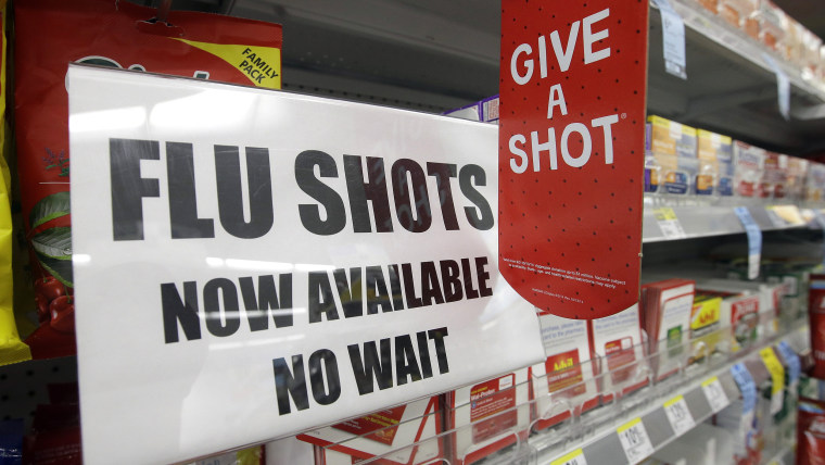 A sign telling customers that they can get a flu shot in a Walgreen store is seen Tuesday, Sept. 16, 2014, in Indianapolis. The nation's biggest drugs...
