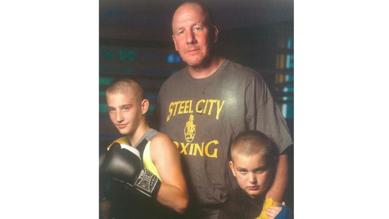 Pittsburgh Detective Jack Mook with the two boys who are now his sons,  Joshua, left, and Jessee.