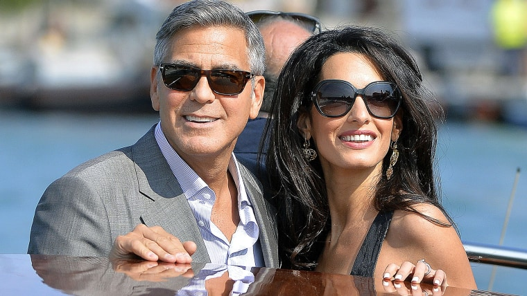 TOPSHOTS US actor George Clooney ( L) and his Lebanon-born British fiancee Amal Alamuddin take a taxiboat upon their arrival in Venice on September 26...
