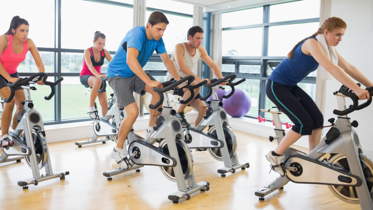 Determined five people working out on exercise bikes in a gym; Shutterstock ID 160505300; PO: today.com