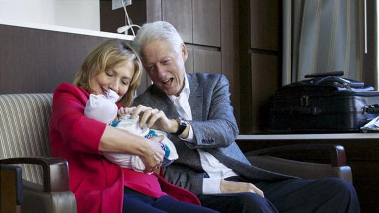 Image: Clintons with their granddaughter