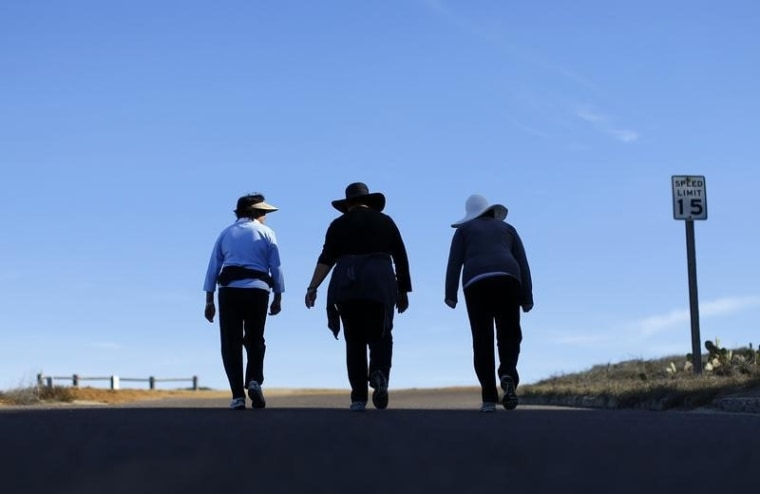 Women walk together up a hill as they participate in some morning exercise during a visit to Torrey Pines State Park in San Diego, California, Novembe...