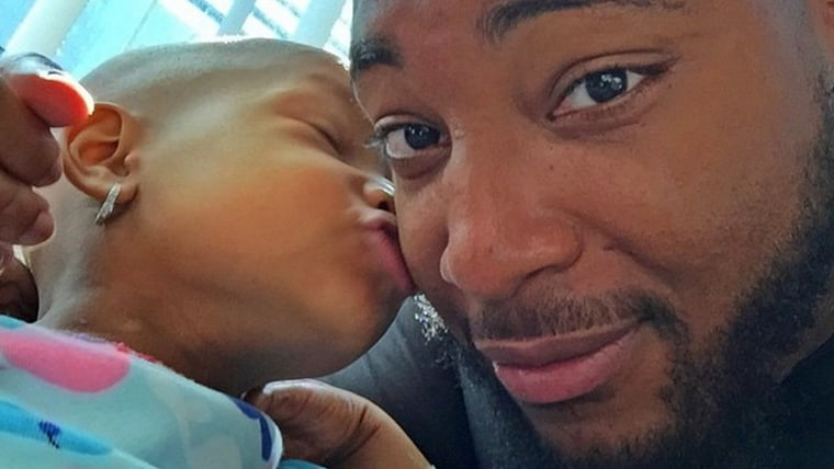 Image: Devon Still and daughter