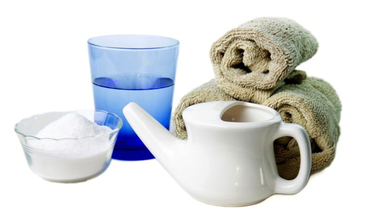 Isolated Neti Pot, used for clearing the nasal passages, shown with a glass of water and salt; Shutterstock ID 40256095; PO: TODAY.com
