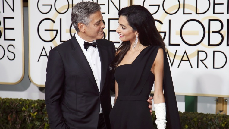 Actor George Clooney and wife, Amal Clooney, arrive at the 72nd Golden Globe Awards in Beverly Hills, California January 11, 2015.  REUTERS/Danny Molo...