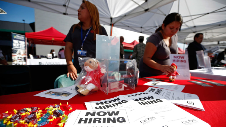 Recruiters wait at a booth at a military veterans' job fair in Carson