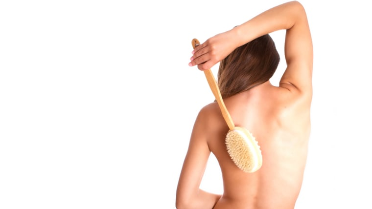 Photo of the woman with brush on back; activity; adult; affectionate; back; background; bathtub; beautiful; beauty; body; brown; brush; care; cosmetic...