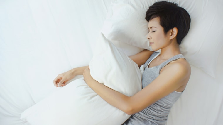 Asian woman sleeping in white bed, view from above; above; adult; asia; asian; asleep; beautiful; bed; bedroom; black hair; brunette; care; casual; cl...