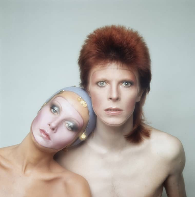 Image: English model Twiggy poses with David Bowie