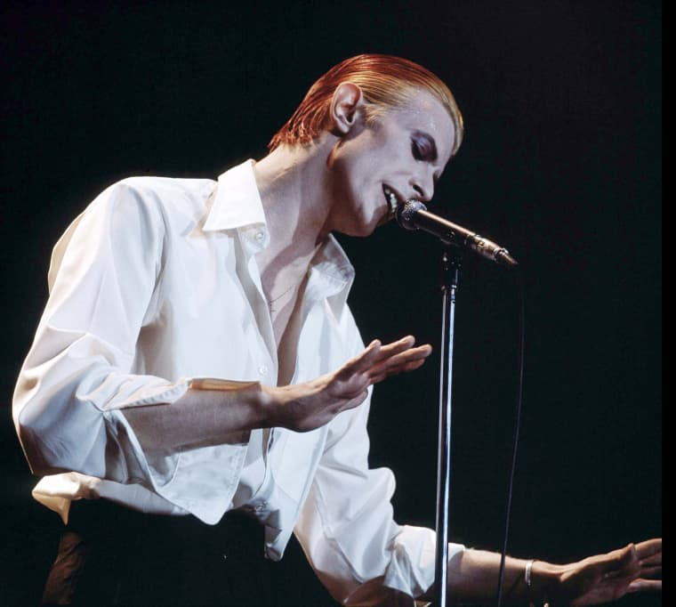 """Image: Singer David Bowie performing on stage as the \""""Thin White Duke\"""""""