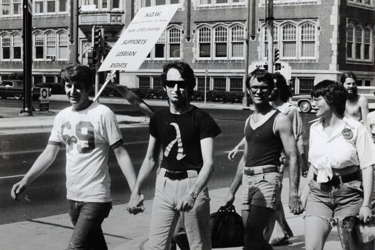 Jack Baker and Michael McConnell, the first same-sex married couple in Minnesota, participate in a Pride Parade in Minneapolis, 1974.