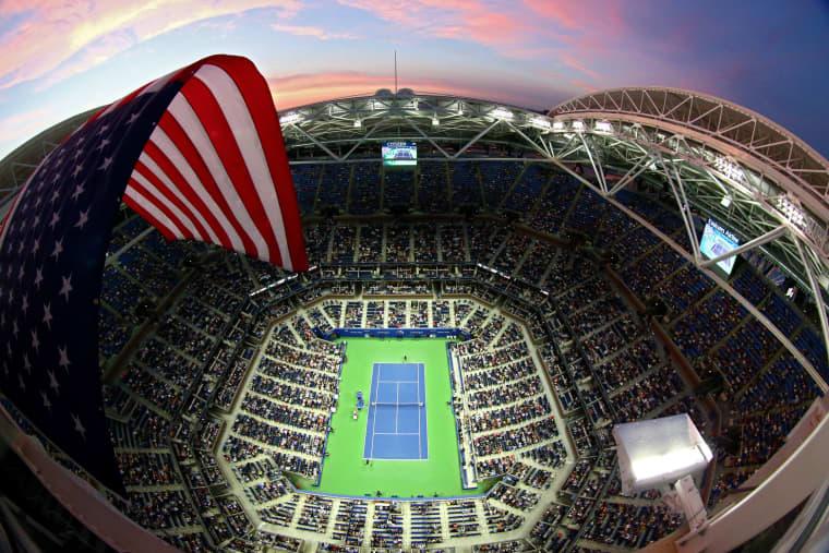 Image: An American flag flies over Arthur Ashe Stadium