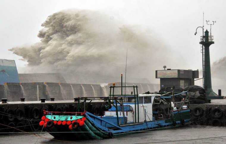 Image: A huge wave breaks over infrastructure at the fishing port in southern Taitung
