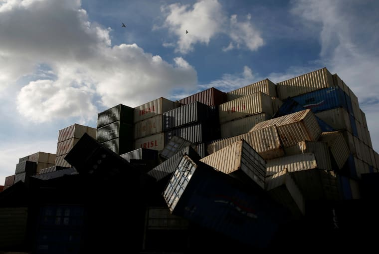 Image: Birds fly over the toppled shipping containers after Typhoon Meranti made landfall, in Kaohsiung