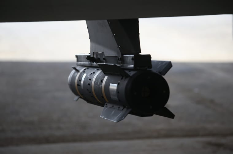Image: A Hellfire missile hangs from a U.S. Air Force MQ-1B Predator