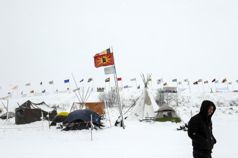 Image: The Oceti Sakowin camp is seen in a snow storm during a protest against plans to pass the Dakota Access pipeline near the Standing Rock Indian Reservation, near Cannon Ball, North Dakota, U.S