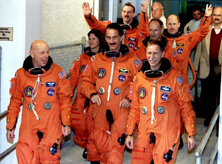 The crew of the space shuttle Endeavour is shown leaving their quarters for the launching pad Decemb..
