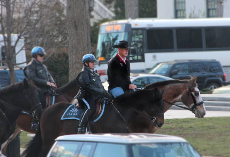 Image: The new Department of the Interior Secretary Ryan Zinke rides a horse to work on his first day