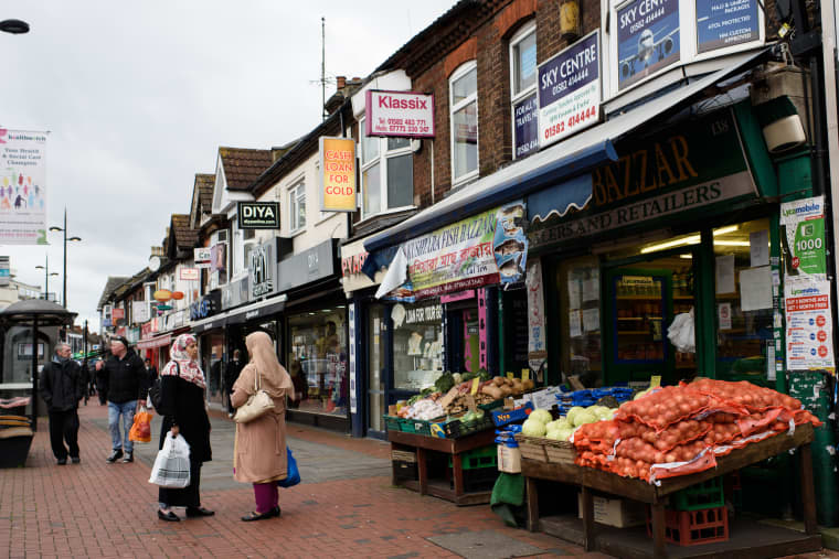 Image: Two women shop at a local grocery in Bury Park, Luton on Feb. 4, 2015.