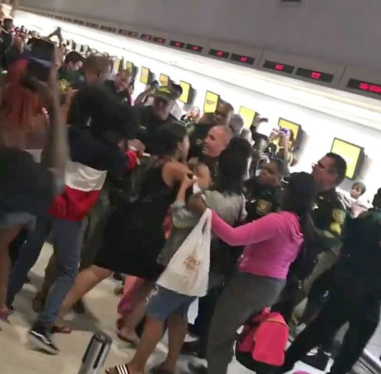 Police and passengers clash at Spirit Airlines counter at the airport in Fort Lauderdale.