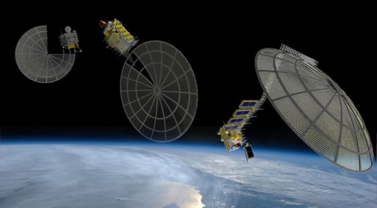 An artist's concept of Made In Space's Archinaut spacecraft 3D-printing and assembling satellite reflectors in space.