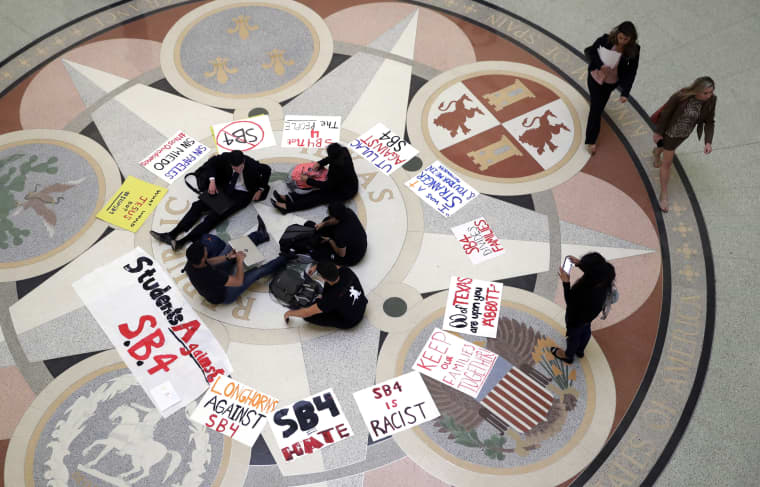 "In this April 26, 2017, file photo, students gather in the Rotunda at the Texas Capitol to oppose SB4, an anti-""sanctuary cities"" bill that already cleared the Texas Senate and seeks to jail sheriffs and other officials who refuse to help enforce federal immigration law, as the Texas House prepares to debate the bill in Austin, Texas."