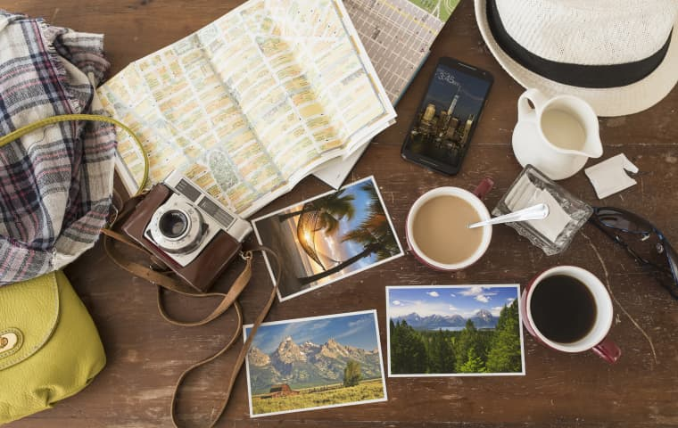 Image: Maps, photographs, a camera and cell phone sit on a table